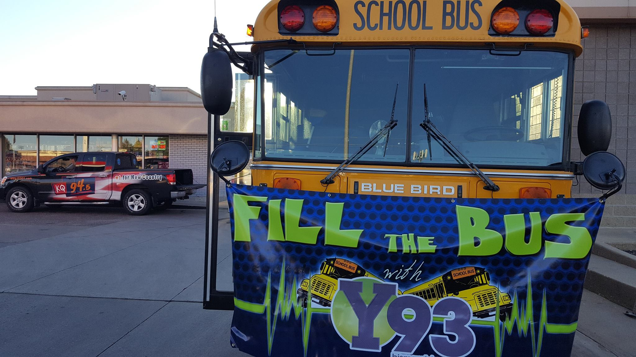 School bus with banner for the annual school supply drive