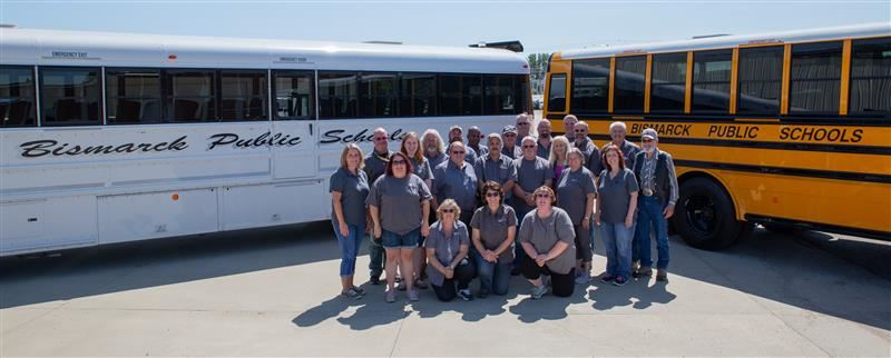 Transportation department with two Bismarck Public Schools buses