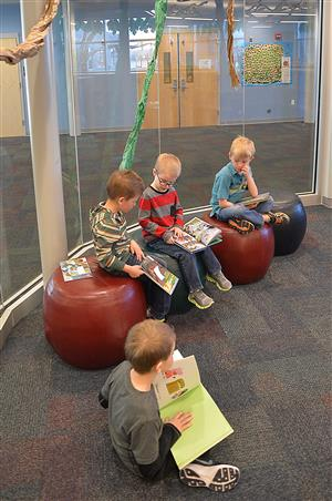 Elementary students reading in a school library